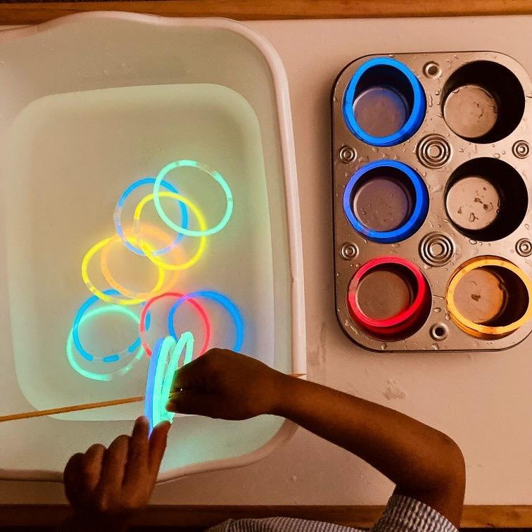 Glow stick sensory play bin for kids