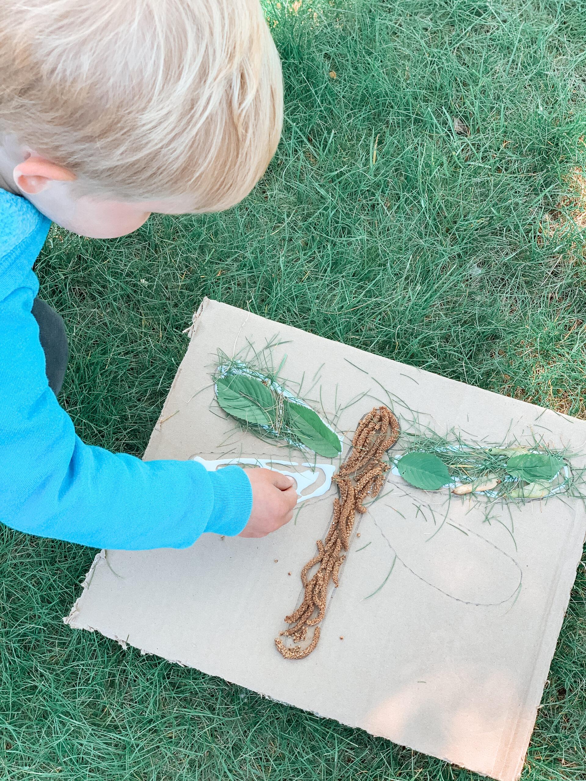 kids creating art with nature and repurposed cardboard