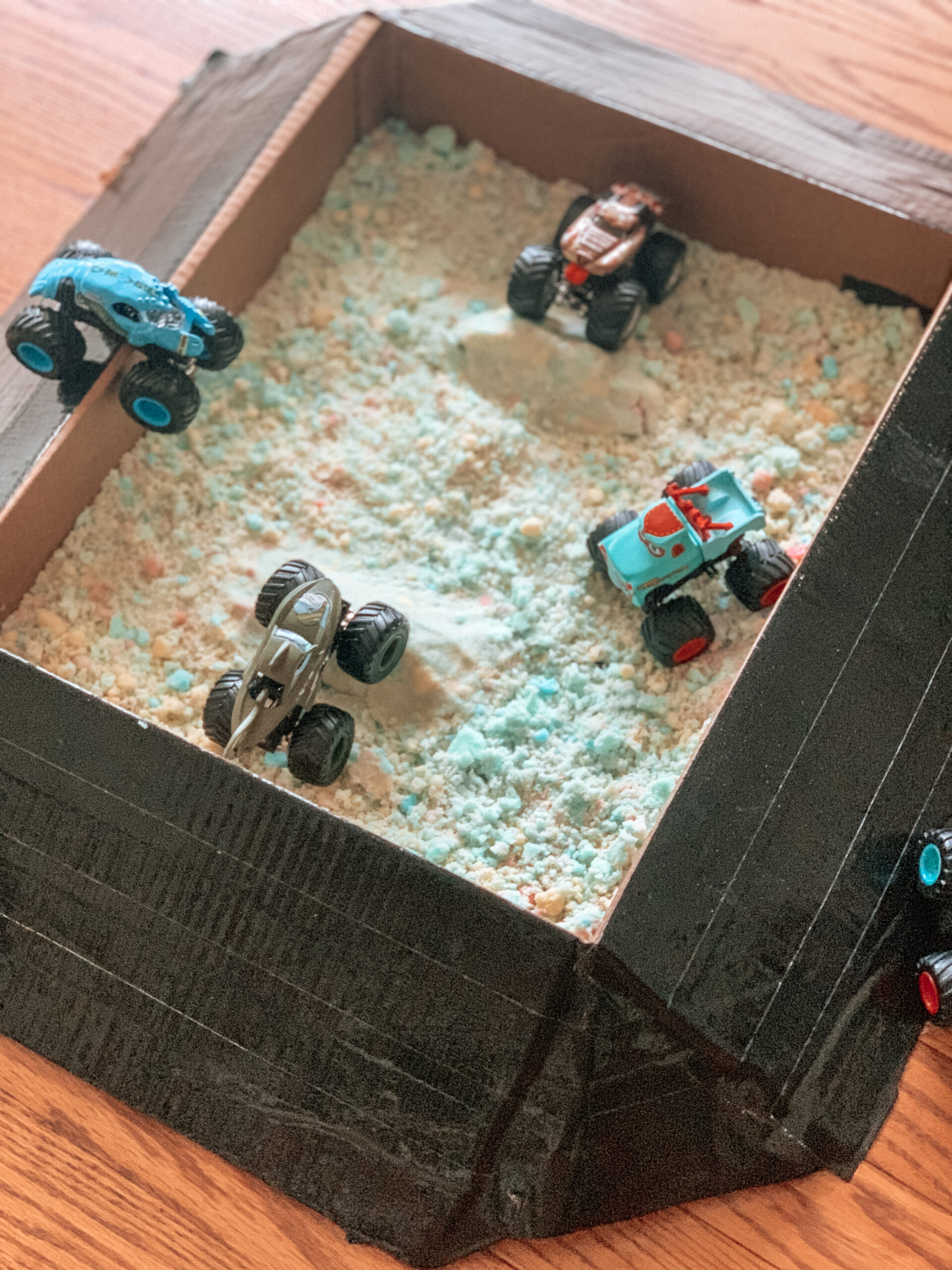 monster truck arena with DIY kinetic sand